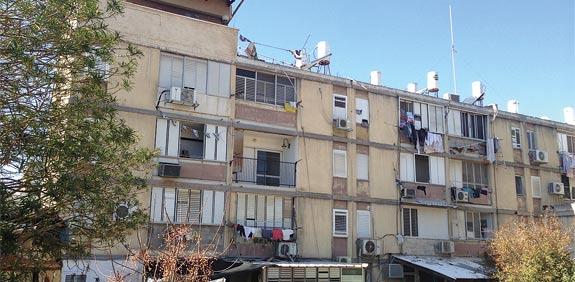 סרבן פינוי-בינוי חויב לשלם מיליון שקל לבעלי הדירות