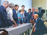 מנהיגי המדינות המתועשות ובראשם אנגלה מרקל מול טראמפ / צילום: רויטרס