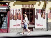 מעדנית חמון במדריד/ צילום: רויטרס, Paul Hanna