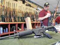 חנות לממכר נשק ביוטה / צילום: רויטרס - Shannon Stapleton