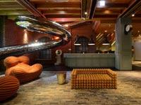 כזה עוד לא ראיתם: בית מלון חדש עם מגלשת ענק ללובי