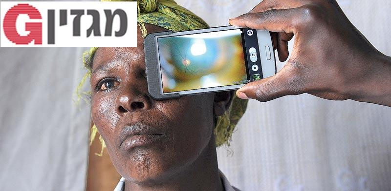 ניסוי באבחון עיניים / צילום: AFP