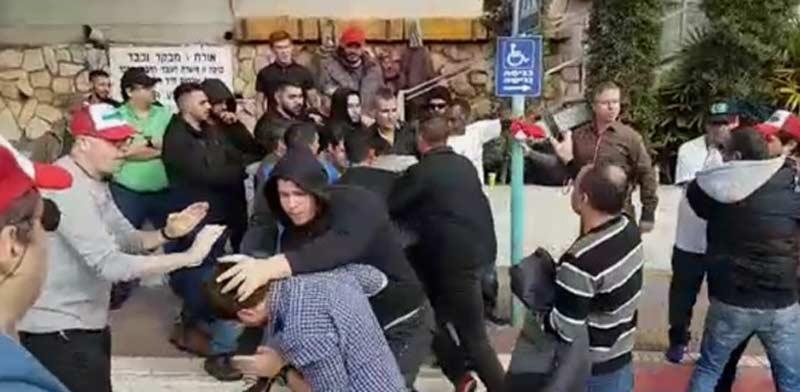 """עובדי ECI מותקפים ע""""י מאבטחים / צילום: עובדי ECI"""
