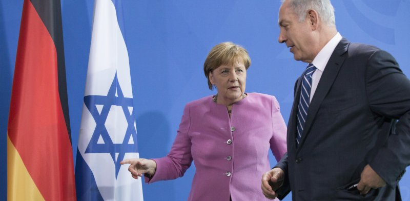 Angela Merkel and Benjamin Netanyahu Photo: ASAP Creative Shutterstock