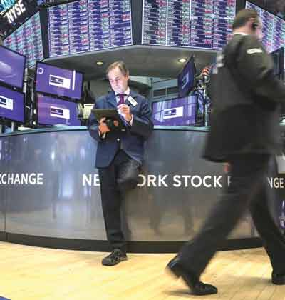 סוחרים בבורסת ניו יורק/ צילום: רויטרס, Brendan McDermid