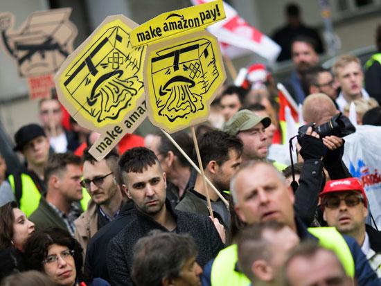 הפגנות נגד אמזון בגרמניה / צילום: AP - Markus Schreiber