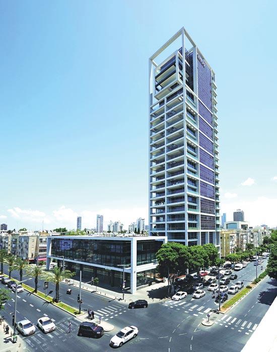 דירה בבנין של גינדי החזקות בתל אביב / צילום: אסף הבר