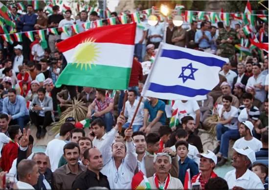 דגלי ישראל מונפים בחגיגות הניצחון במשאל העם בכורדיסטן / צילום: רויטרס