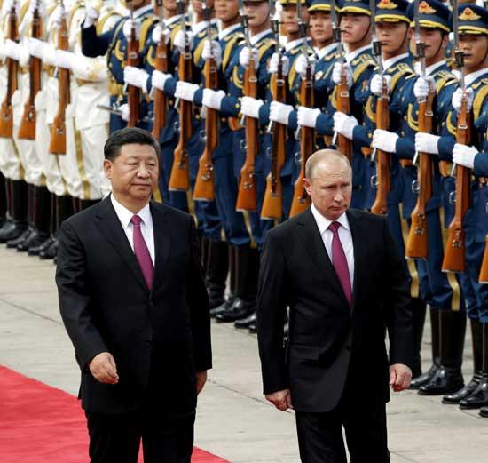 נשיא רוסיה פוטין ונשיא סין ג'ינפינג / צילום:רויטרס Jason Lee