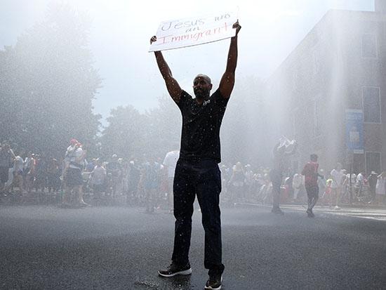 מפגין ממרילנד במחאה נגד מדיניות הפרדת ילדי המהגרים ממקסיקו / צילום: רויטרס - Joshua Roberts