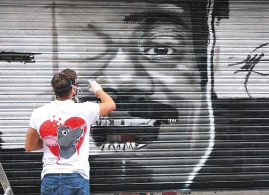 אמנות רחוב בלונדון/ צילום: Shutterstock/ א.ס.א.פ קרייטיב