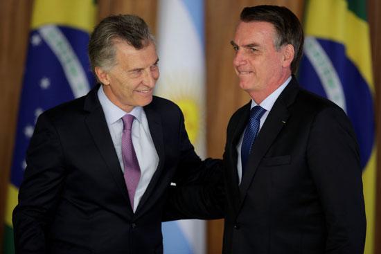 הנשיא מאקרי (משמאל) יחד עם נשיא ברזיל בולסונרו / צילום: רויטרס - Sergio Moraes