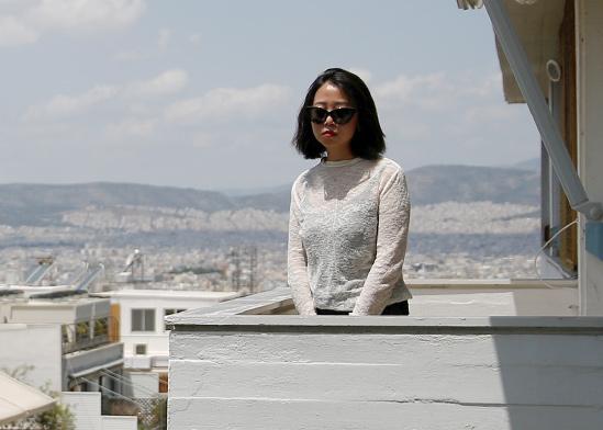 ליאן וונמין, רואת חשבון מסין, בביקור באתונה / צילום: COSTAS BALTA, רויטרס