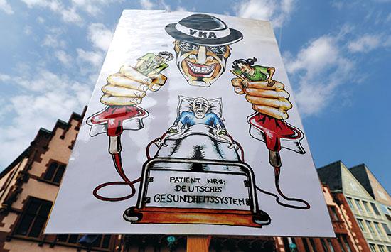 """""""הפציינט מס' 1: מערכת הבריאות הגרמנית"""" - גם הרופאים הגרמנים מוחים על שכרם / צילום: רויטרס"""