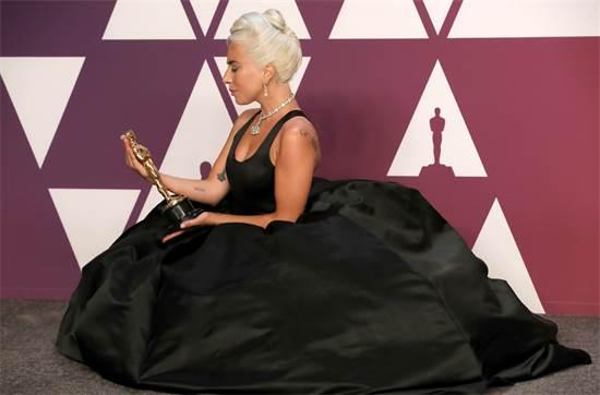 ליידי גאגא והאוסקר על השיר הטוב ביותר / צילום: REUTERS/Mike Segar
