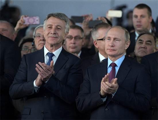 נשיא רוסיה ולדימיר פוטין והאוליגרך לאוניד מיכלסון / צילום: Alexei Druzhinin, ספוטניק