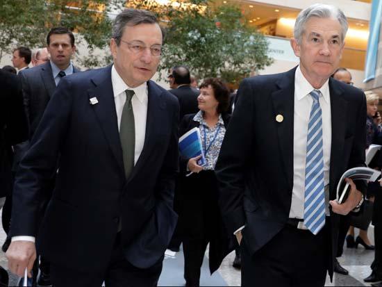 """יו""""ר הפד ריזרב ג'רום פאוול  ויו""""ר ה־ECB מריו דראגי / צילום: רויטרס"""