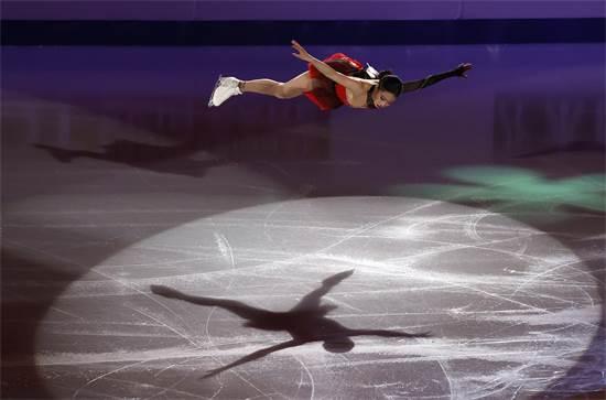 מחליקת הקרח הדרום קוריאנית יו יאנג בתחרות ההחלקה על הקרח / צילום: Lee Jin-man, AP