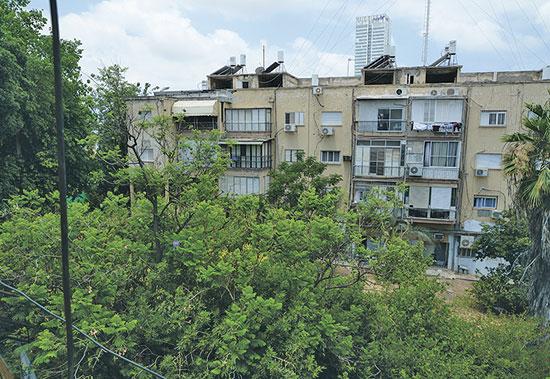 חלק מהבניינים בפרויקט. 10 דונם שעליהם 58 דירות ועשר חנויות / צילום: איל יצהר, גלובס