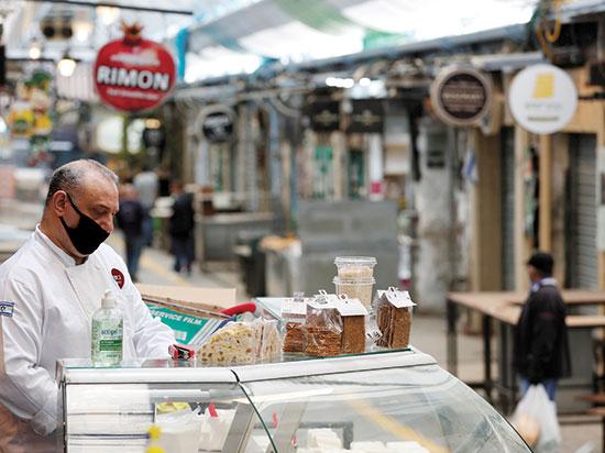 שוק מחנה יהודה בימי קורונה / צילום: רויטרס