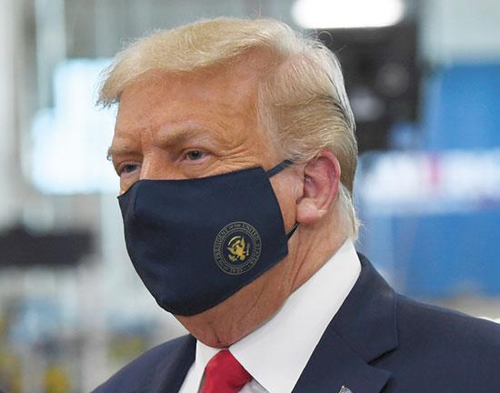 טראמפ. המעיט בחשיבות הקורונה / צילום: Susan Walsh, Associated Press
