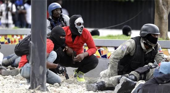 קרב יריות בהאיטי / צילום: דיאו נאליו שרי, AP