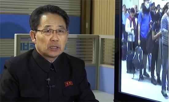 """מנכ""""ל משרד הבריאות בצפון קוריאה מזהיר מפני נגיף הקורונה בטלוויזיה הלאומית / צילום: AP Photo, AP"""