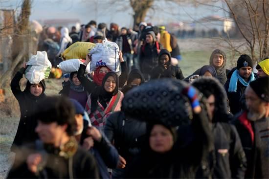 פליטים בגבול טורקיה-יוון / צילום: Emre Tazegul, AP