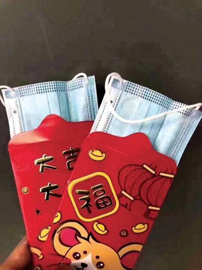 גולשים החליפו את המזומנים במעטפות האדומות לרגל חג השנה הסיני במסכות פנים/  צילום: מתוך וויבו
