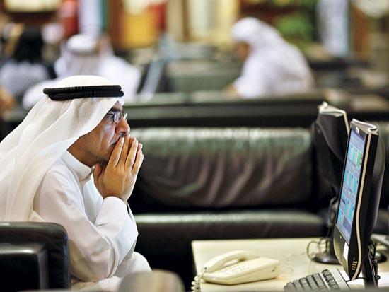 סוחר בבורסה בדובאי / צלם רויטרס