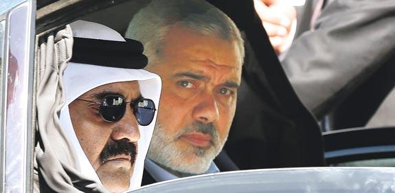 שייח' חמד בן חליפה א-ת'אני ואיסמעיל הנייה / צילום: רויטרס