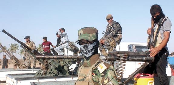 "מתנדב בצבא העיראקי הנלחם בדאע""ש  / צילום: רויטרס"