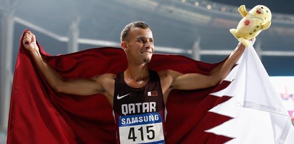אצן קטארי חוגג זכייה במדליית זהב במשחקי אסיה 2014 / צלם: רויטרס