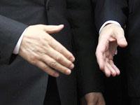 לחיצת יד, הסכמה, עסקים, הסכם / צלם רויטרס