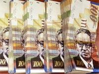כסף 100 שקלים שטרות / צלם: בלומברג