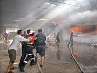 מפעל שנפגע סמוך לשדרות / צילום: רויטרס