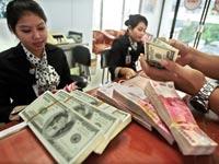 ין יפני ודולר אמריקני / צילום: רויטרס