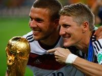 בסטיאן שוויינשטייגר, לוקאס פודולסקי, נבחרת גרמניה זוכה בגביע העולם 2014 / צלם: רויטרס