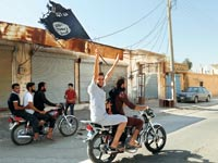 """תומך סורי בדאע""""ש / צילום: רויטרס"""