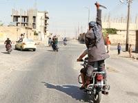 """פעיל דאע""""ש / צילום: רויטרס"""