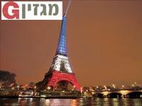 מגדל אייפל מואר בצבעי דגל צרפת/ צילום:רויטרס