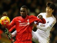 כריסטיאן בנטקה מול קי סונג יונג, ליברפול נגד סוונזי, פרמיירליג / צלם: רויטרס