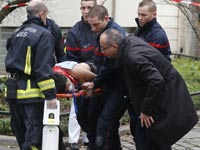 "פיגוע בעיתון ""שרלי הבדו"" - פריז / צלם: רויטרס"