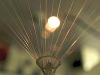 סיבים אופטיים של אלקטל–לוסנט /  צילום: בלומברג