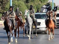 לוחמים של דאעש / צילום: רויטרס