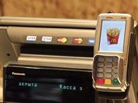 מכשיר תשלום בכרטיס אשראי / צילום: בלומברג