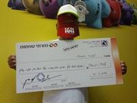 """הזוכה המאושר ב56 מיליון ש""""ח בלוטו / צילום: דן לב"""