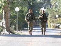חיילים באחד מישובי עוטף עזה / צילום: רויטרס