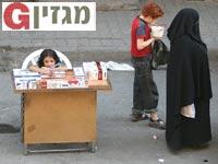 ילדה בדוכן סיגריות בחאלב, סוריה / צילום: רויטרס