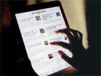 אפליקציית הניו יורק טיימס / צילום: בלומברג